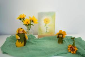 Zonnebloem popjes van vilt op de seizoentafel in de nazomer