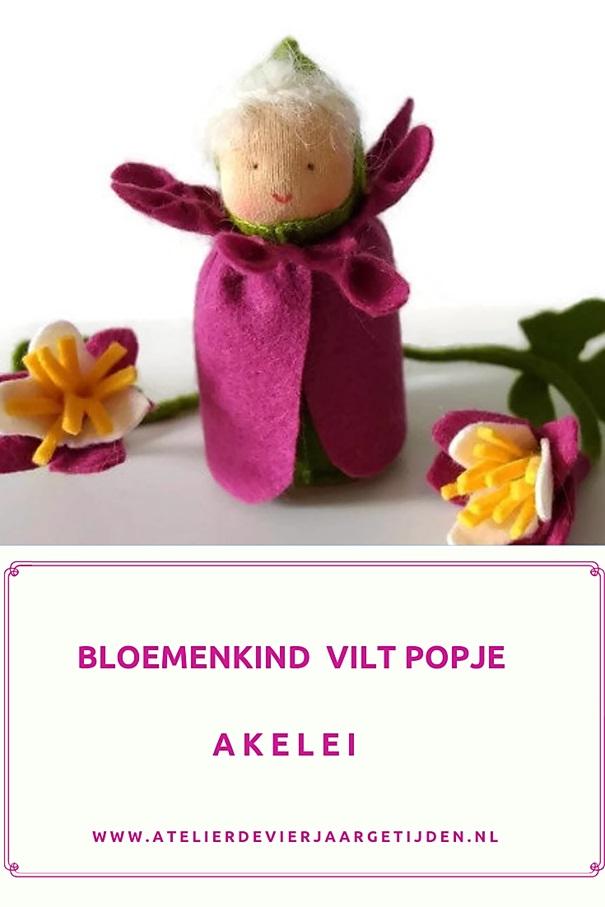 Vilt bloemen popje voor op de seizoentafel